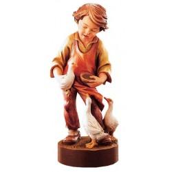 Un bambino vivace porta a passeggio le oche - Dolfi sculture in legno animali, Ortisei