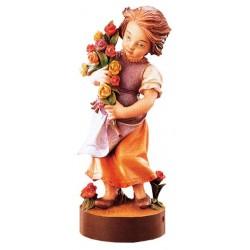 Mädchen aus Holz mit Blumen