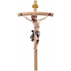 Corpo di Cristo classico scolpito con forza e spiritualità su croce curva chiara, Val Gardena - manto blu