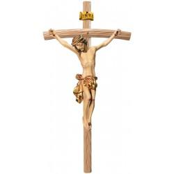 Corpo di Cristo classico scolpito con forza e spiritualità su croce curva chiara, Val Gardena - drappo dorato