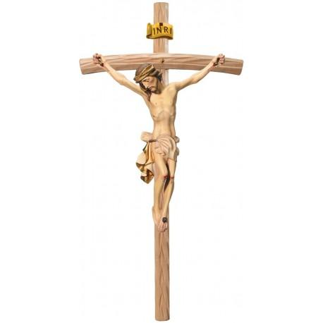 Christuskörper auf gebogenen hellen Balken - Weißes Tuch