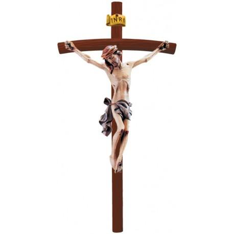 Christuskörper auf gebogenen dunklen Balken - Blaues Tuch