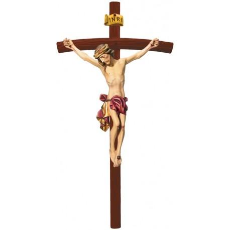 Christuskörper auf gebogenen dunklen Balken - Rotes Tuch