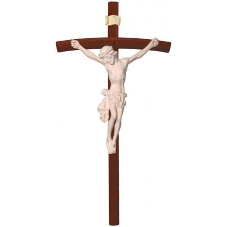 Christuskörper auf gebogenen dunklen Balken - Natur