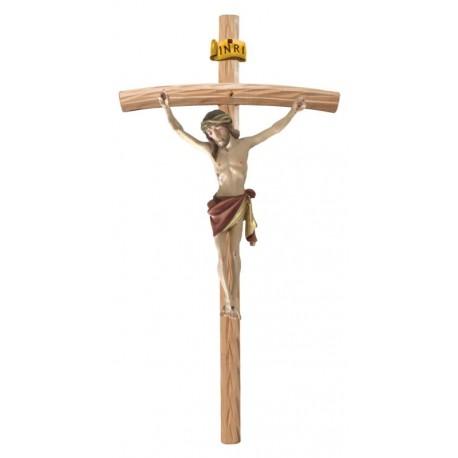 Christuskörper aus Holz auf gebogenen hellen Balken - Rotes Tuch