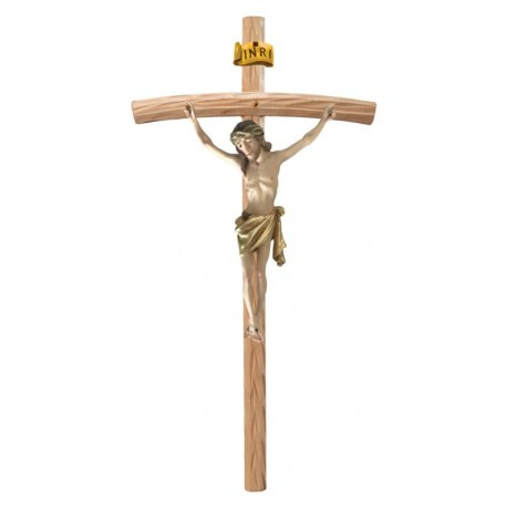 Christuskörper aus Holz auf gebogenen hellen Balken - Vergoldetes Tuch