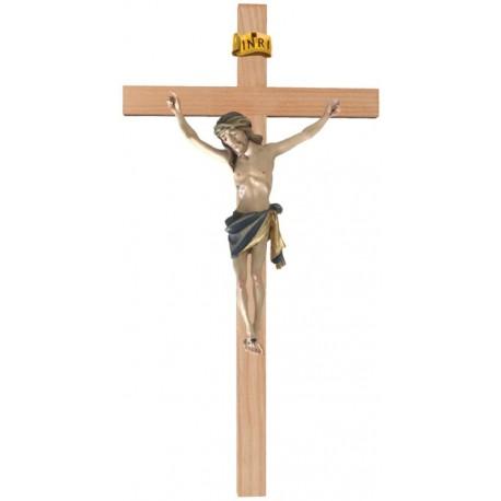 Christuskörper aus Holz auf gebogenem Balken - Blaues Tuch