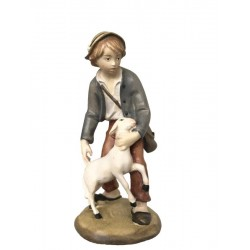 Shepherd in wood with sheep - color