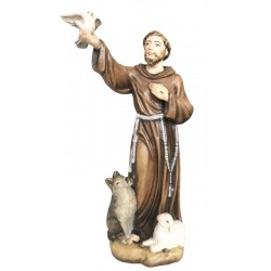 Saint Francis from Assisi with flying dove in his hand - lightly colored with oil paint