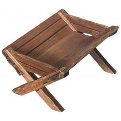 Wiege aus Holz für Jesus Kind, diese Holzfigur zählt zu den wichtigsten Grödner Holzschnitzereien - Mittel braun