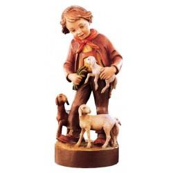 Fanciullo con pecore di legno
