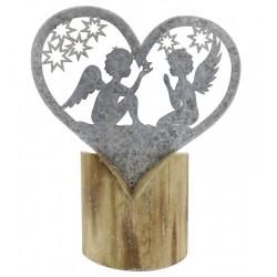Cuore in metallo su tronchetto in legno