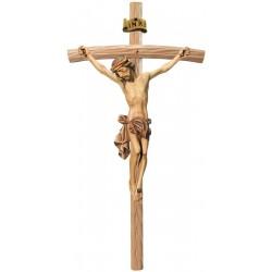 Corpo di Cristo classico scolpito con forza e spiritualità su croce curva chiara, Val Gardena - colori ad olio