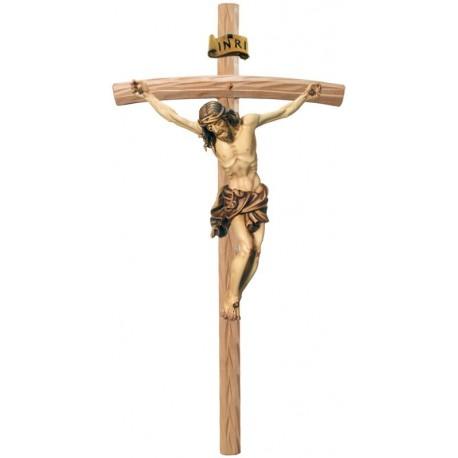 Corpo di Cristo moderno scolpito con forza e spiritualità su croce - legno colorato in diverse tonalitá di marrone