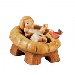 Jesuskind mit separater Wiege als Barren ist eine Südtiroler Krippenfigur aus Ahornholz geschnitzt