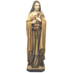 Die Statue der hl. Theresia von Lisieux mit Rosen, Kruzifix im Arm ist die hl. Thérèse als Holzfigur - Brauntöne lasiert