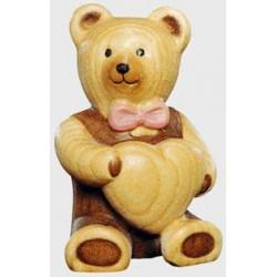 Tenero orsacchiotto con cuore scolpito in legno