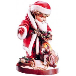 Weihnachtsmann mit Sack als Holzfigur