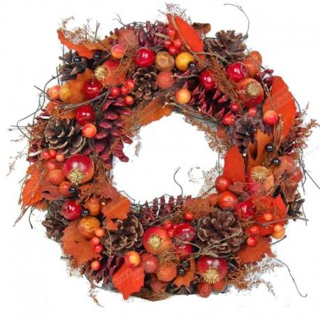 Corona della collezione con pigne e bacche arancio