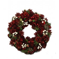 Corona della collezione naturale con pigne rosse
