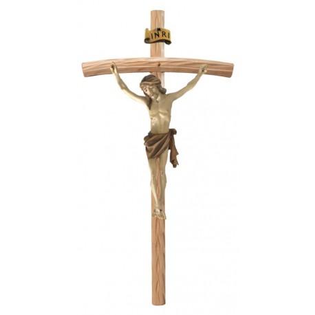 Christuskörper aus Holz auf gebogenen hellen Balken - mehrfach gebeizt